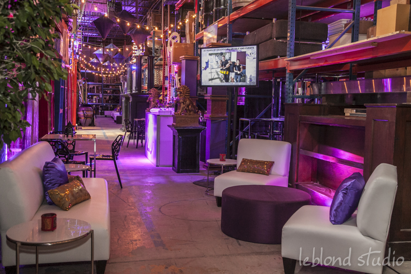 The warehouse was transformed into an upscale Streets of Toronto, one of Décor & More's signature installs, with each aisle representing a different district of the city. Chinatown was showcased with an abundance of purple lanterns strung overhead as well as other Asian inspired elements at food stations or tucked into lounges.