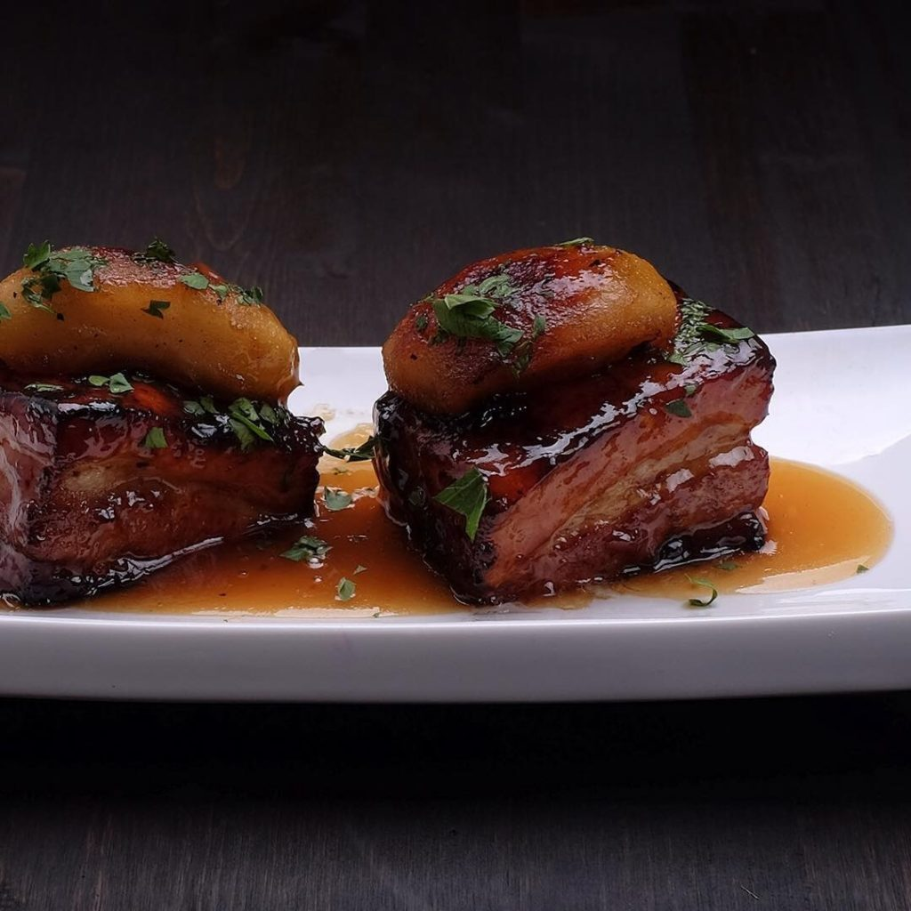 porkbelly with calvados glaze and roasted apple by Savoury City Catering