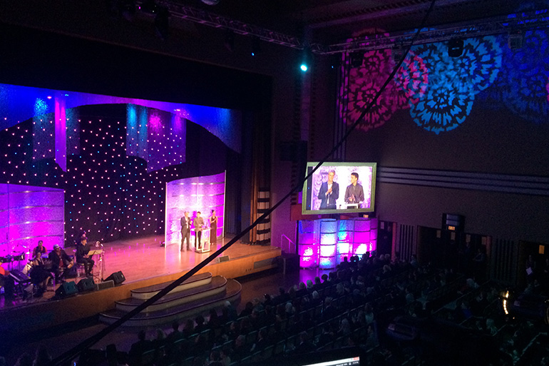 Lighting on string curtains, fibre optic curtains, gobos on side walls for an awards gala Freeman audio visual.
